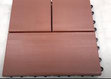 Composite deck tile after blow torch removes scratches