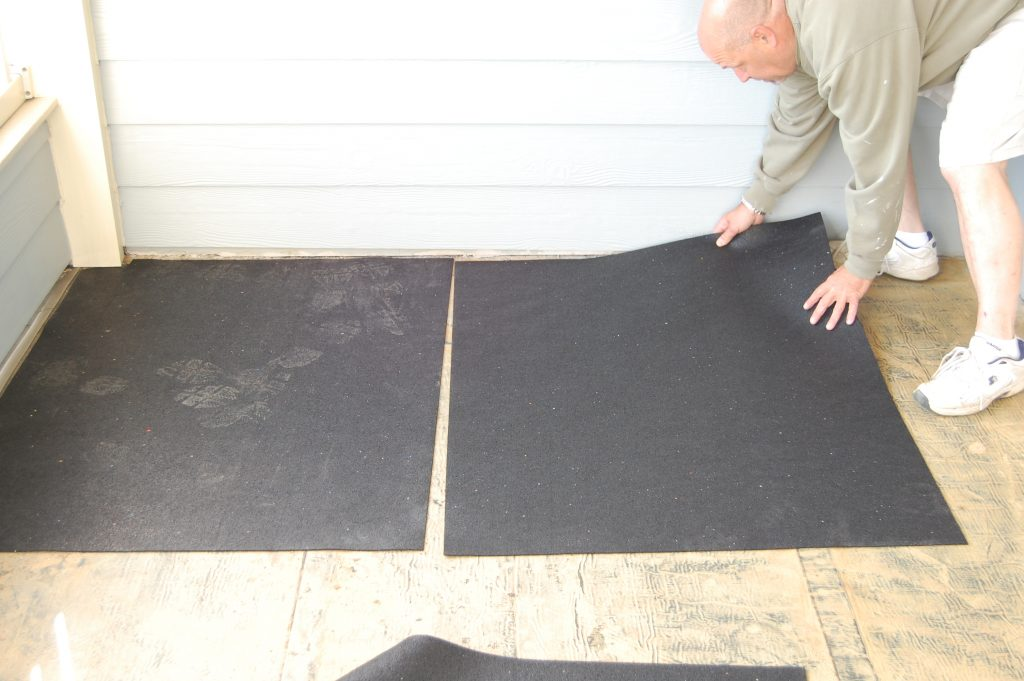 Laying Protection Mat for Composite Deck Tiles