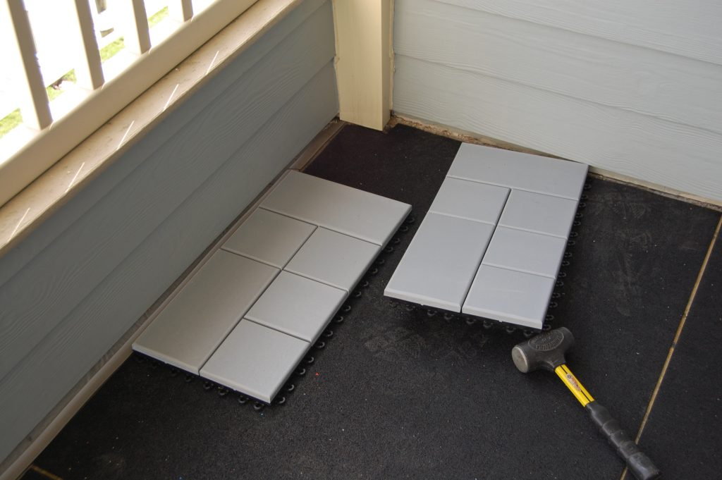 Begin laying Composite Deck Tiles on the outside Edge