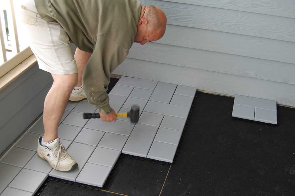 Connecting Weatherstone Composite Deck Tiles with a Dead Blow Mallet